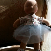A bald doll by Louie Louie Bebe Waldorf doll