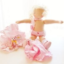 A pink ballerina Waldorf doll by Louie Louie Bebe