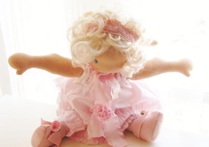 A Pink Ballerina doll by Louie Louie Bebe