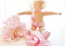 A pink ballerina Waldorf doll by Louie Louie Bebe
